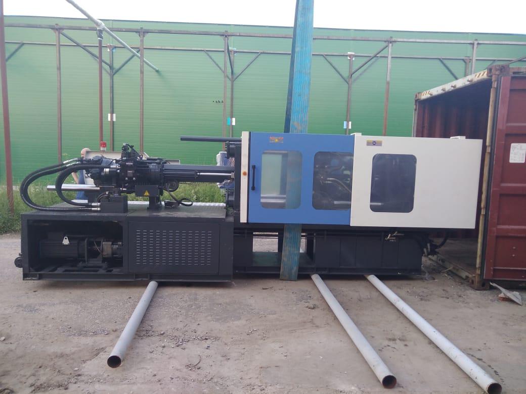 Доставка термопластавтоматов и этикетировочной машины